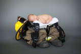 newborn with firefighter gear